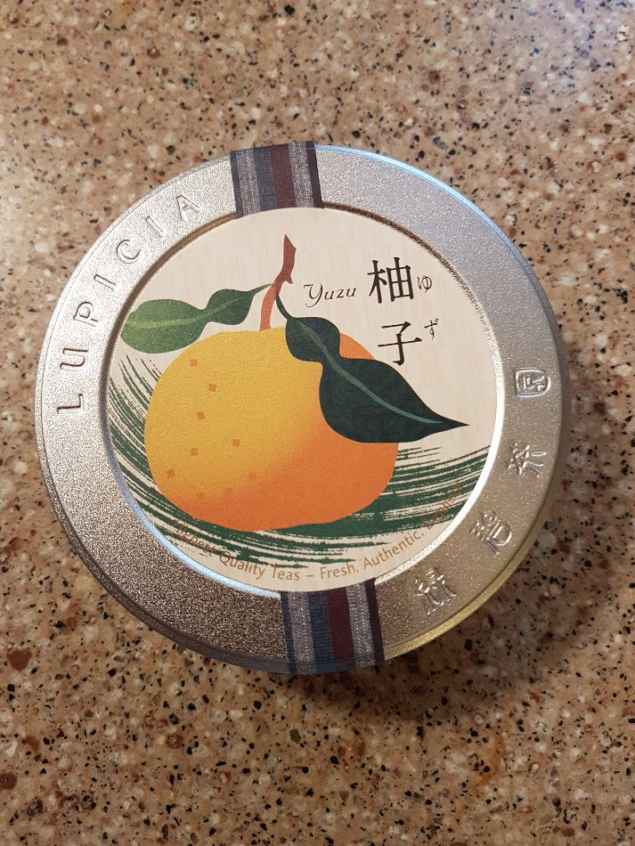 A metal tin of yuzu green tea from Lupicia