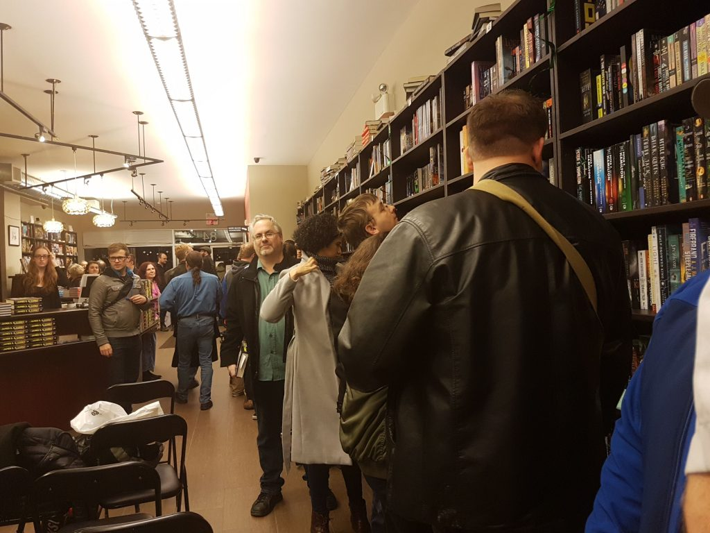 People at the book launch waiting in line to get their copies of Persepolis Rising signed.