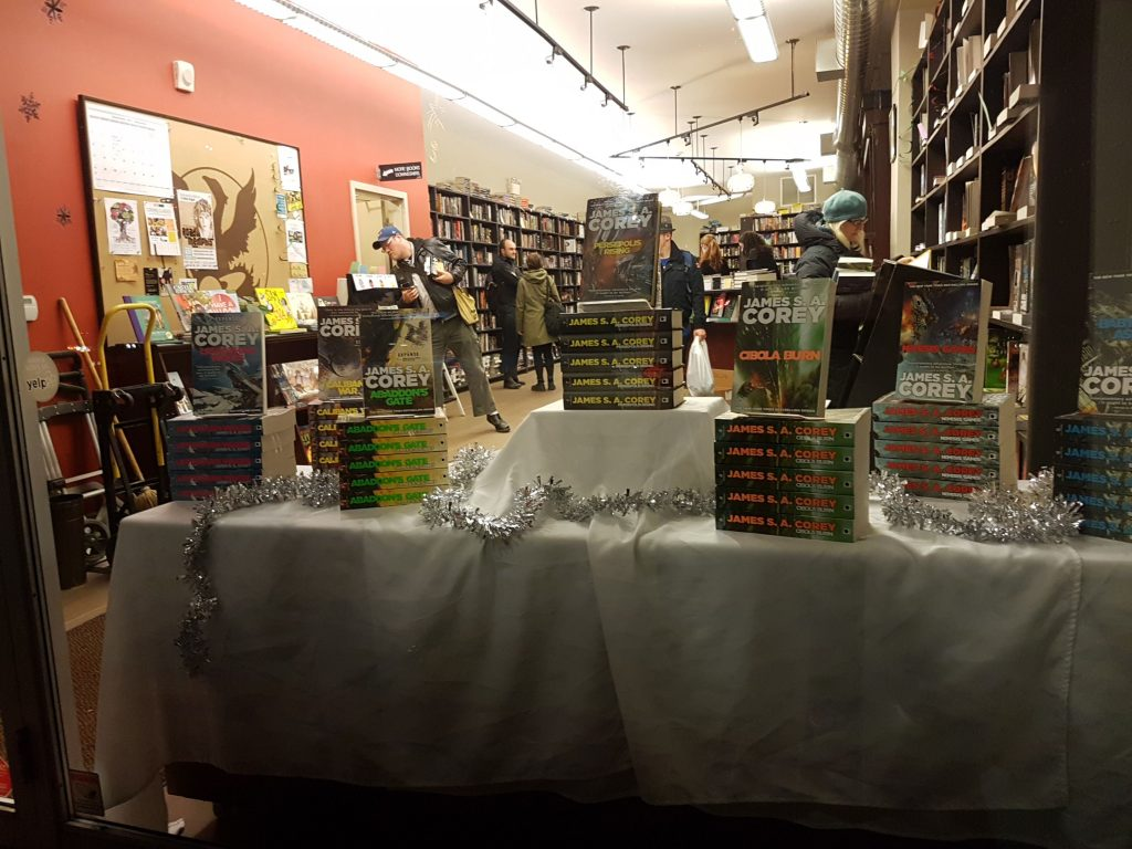 A photo of the storefront of Bakka Phoenix Books, showing many copies of various volumes of the Expanse series by James S.A. Corey.