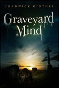 The cover of Graveyard Mind, by Chadwick Ginther, shows a graveyard and tombstones silhouetted by a cloudy horizon.